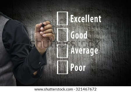 Businessman hand writing and Performance evaluation checkbox - stock photo