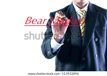 Businessman hand writing Bear Market on transparent wipe board.
