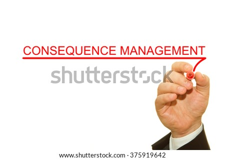 Businessman hand writing Consequence Management on a transparent wipe board