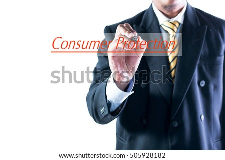 Businessman hand writing Consumer Protection transparent wipe board.