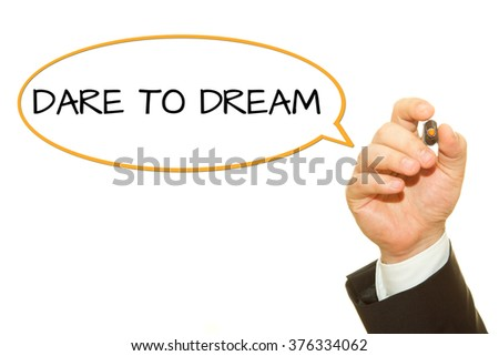Businessman hand writing DARE TO DREAM on a transparent wipe board