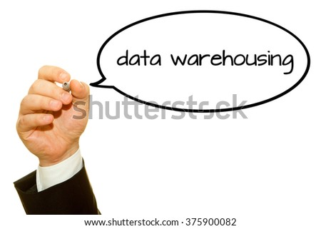 Businessman hand writing data warehousing word on a transparent wipe board.