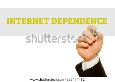 Businessman hand writing Internet Dependence isolated on white. - stock photo