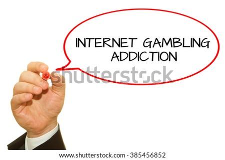 Businessman hand writing Internet Gambling Addiction isolated on white. - stock photo