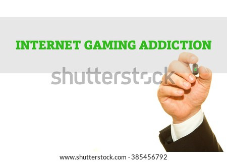 Businessman hand writing Internet Gaming Addiction isolated on white. - stock photo