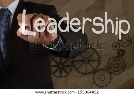 businessman hand writing leadership skill with gear on crumpled recycle background as concept - stock photo