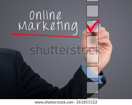 Businessman hand writing online marketing and check listing task. Isolated on grey background. Stock photo