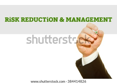 Businessman hand writing Risk Reduction and Management isolated on white.