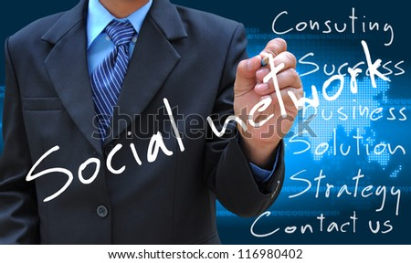 businessman hand writing social network - stock photo