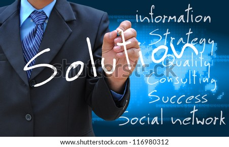 businessman hand writing solution - stock photo