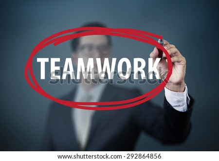"Businessman hand writing ""Teamwork"" with red marker on transparent board, new business concept, studio  shot - stock photo"