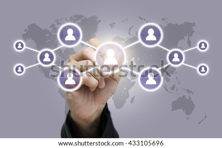 Businessman hand writing the Social media symbol on world map,Elements of this image furnished by NASA, Business network concept