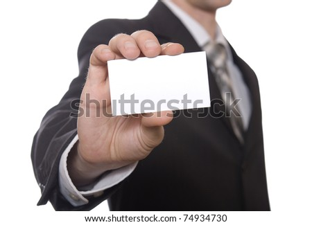 Businessman handing a blank business card over white
