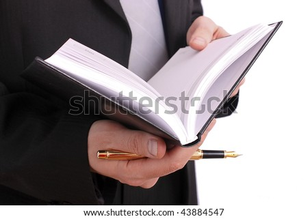 Businessman handing a book and gold pen - stock photo