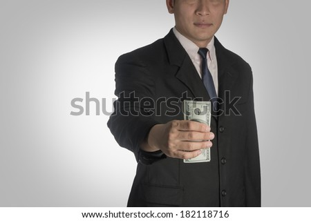 Businessman handing money to you. - stock photo