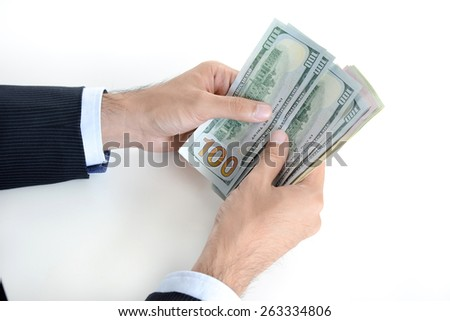Businessman hands counting money,US dollar (USD) bills, on white background - stock photo