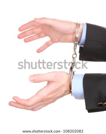 Businessman hands fettered with handcuffs isolated on white - stock photo