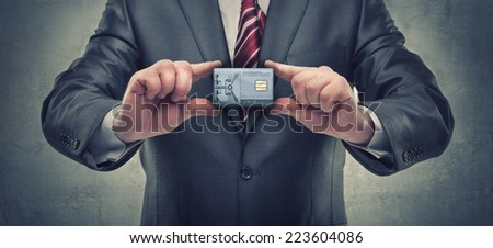 businessman hands holding silver card with safe door  - stock photo