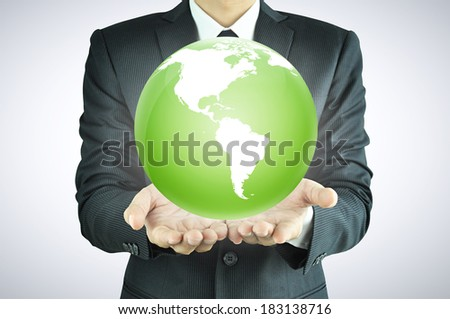 Businessman hands holding the globe  - worldwide service, rule the world,   world domination concepts etc.