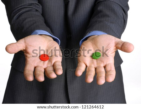 Businessman hands holding two pills. - stock photo