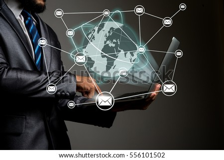 Businessman hands on laptop with global connection network technology , Business concept.