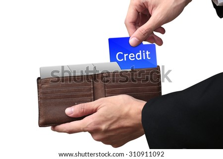 Businessman hands pulling red folder CREDIT concept on brown wallet. - stock photo