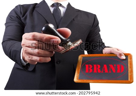 businessman hands put the stamp wood blackboard red brand word stamp on white background with clipping path - stock photo