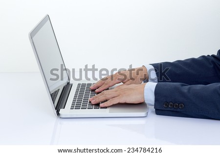 Businessman hands typing on laptop computer - stock photo