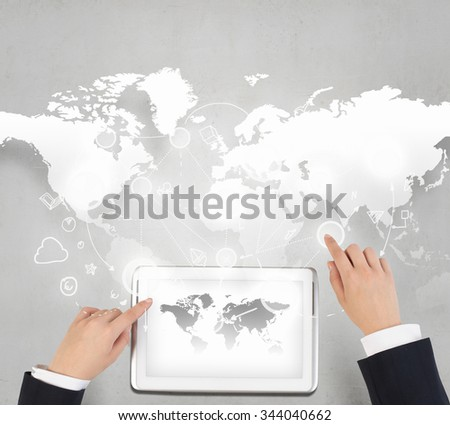 Businessman hands working on tablet with world map on screen - stock photo