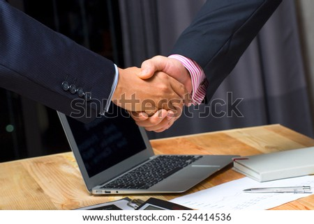 businessman handshake together on blue meeting room background in agreement,accept,approve financial cooperative goal,team international invest