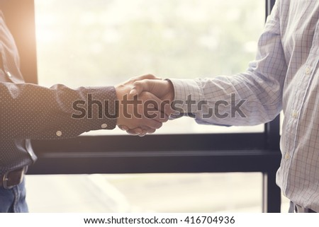businessman handshaking for business cooperation and acquisiton concept, selective focus and vintage tone