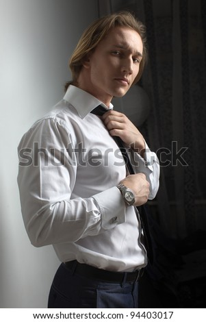 Businessman, handsome man athletic, posing in studio - stock photo