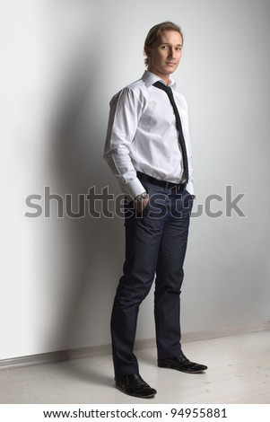 Businessman, handsome man athletic posing in studio - stock photo