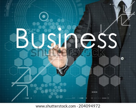 businessman handwriting Business on a transparent board - stock photo