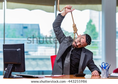 Businessman hanging himself after bankruptcy - stock photo