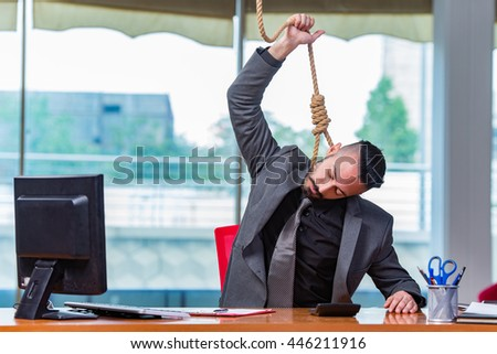 Businessman hanging himself after bankruptcy - stock photo
