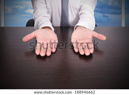 businessman hangs with palms up - stock photo