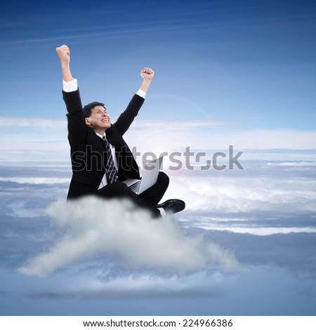 Businessman happiness after success with his project on the cloud  - stock photo