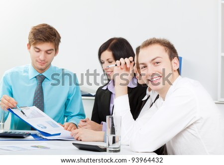 businessman happy smile, young business people working on project in team together, businessmen and women discussing the financial diagram, graph, charts, businesspeople meeting sitting at desk office