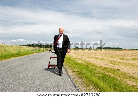 Businessman harvesting the fruits of his labor - stock photo