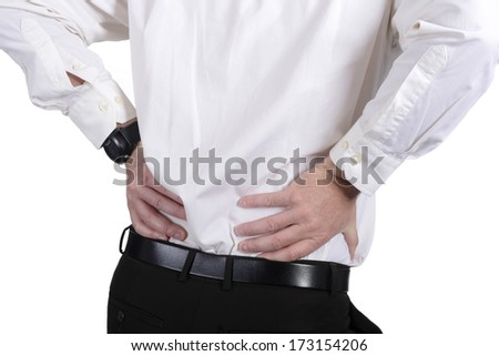 businessman has a lumbago, rear view - stock photo