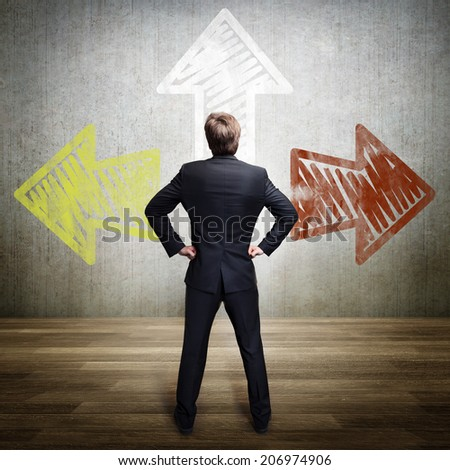 businessman has to choose between 3 options  - stock photo