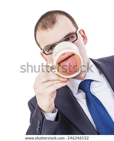Businessman Have coffee break. Thoughtful young adult white collar man holding cup of coffee and looking away while standing isolated on white Protruding tongue on button beige can Fanny idea concept - stock photo
