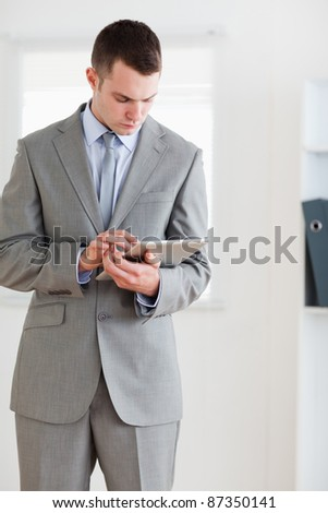Businessman having a careful look at his notes
