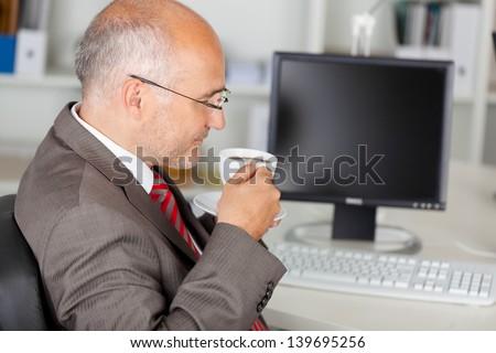 businessman having a coffee break in the office - stock photo