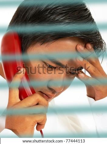 Businessman having a conversation on the telephone - stock photo