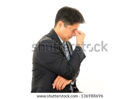 Businessman having a headache - stock photo