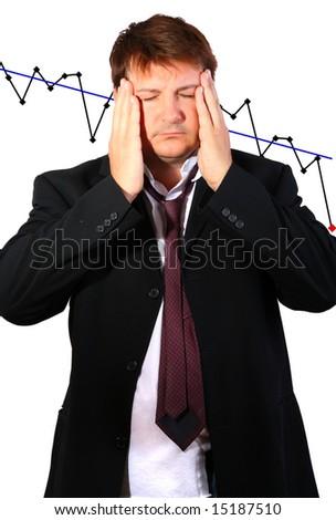 Businessman having a headache (economy going down - conceptual) - stock photo