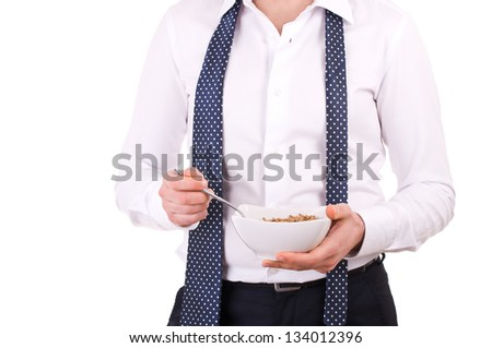 Businessman having breakfast with cereal bowl. - stock photo