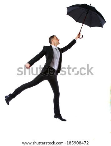 Businessman having fun with umbrella isolated on a white background - stock photo